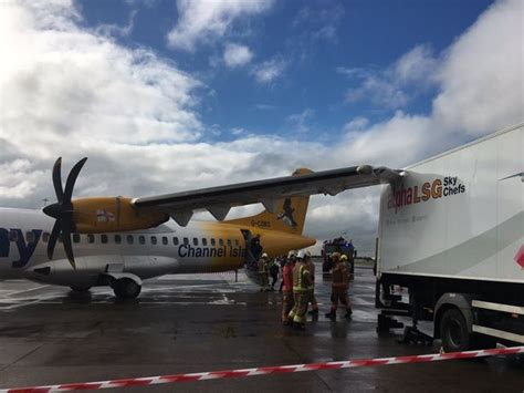 Plane crashes into catering truck at Manchester Airport